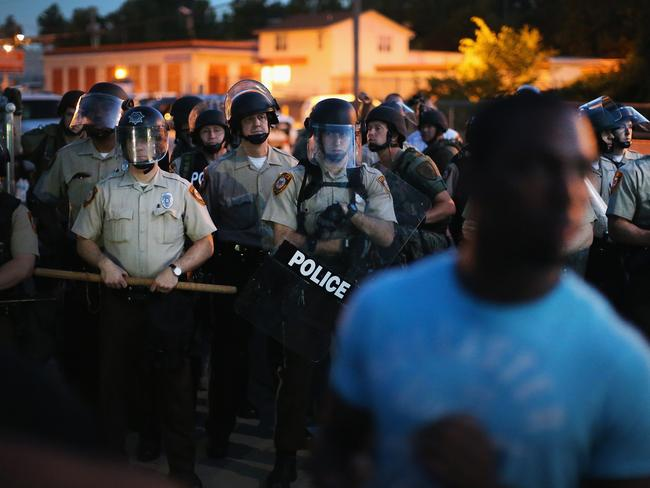 Police state? ... Cops stand watch as demonstrators protest the shooting death of teenager Michael Brown. Picture: Getty