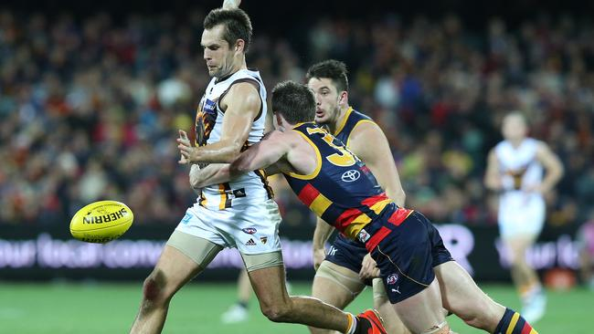 Patrick Dangerfield runs down Luke Hodge at Adelaide Oval. Picture: Sarah Reed