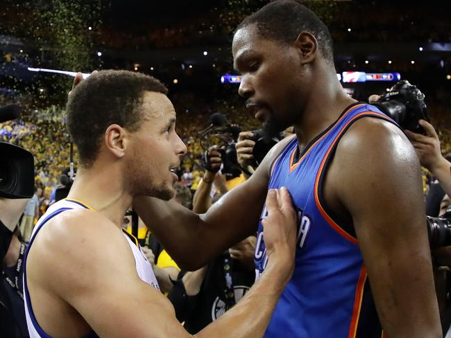 Stephen Curry speaks with Kevin Durant after the Western Conference Finals.