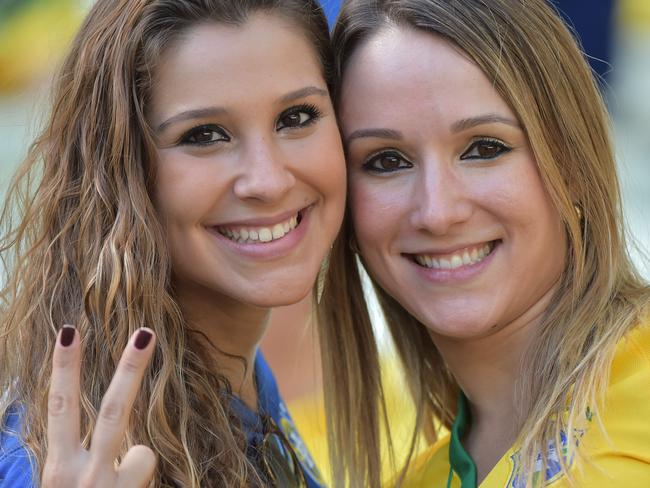 Brazilian fans smile ahead of their nation's quarter-final match against Colombia.