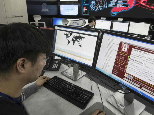 (FILES) This file photo taken on May 15, 2017 shows staff monitoring the spread of ransomware cyber-attacks at the Korea Internet and Security Agency (KISA) in Seoul. In the aftermath of major cyber attacks, of which recent examples have shown potential dramatic consequences, experts and the Microsoft IT company are advocating the creation of a private international NGO.  / AFP PHOTO / YONHAP / YONHAP / REPUBLIC OF KOREA OUT  NO ARCHIVES  RESTRICTED TO SUBSCRIPTION USE