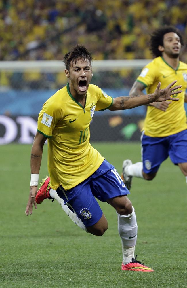 Brazil's Neymar celebrates after scoring his side's first goal during the Group A 2014 World Cup match and Croatia in Sao Paulo.