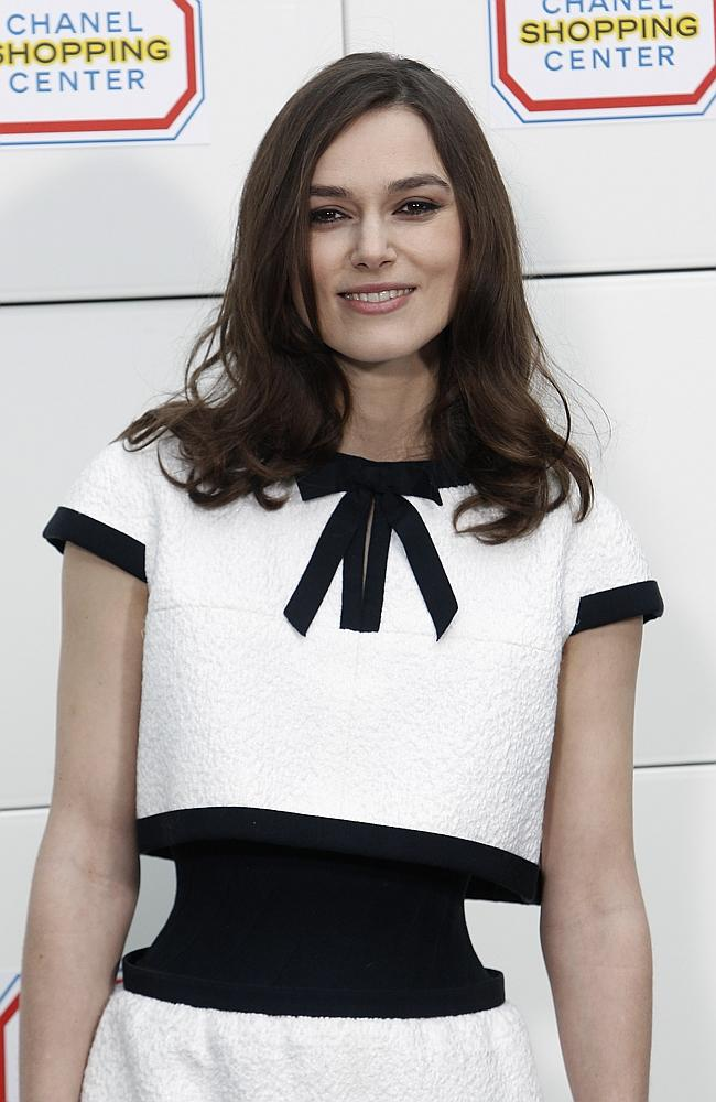 Actress Keira Knightley poses as she arrives to Chanel's ready to wear fall/winter 2014-2015 fashion collection presented in Paris, Tuesday, March 4, 2014. (AP Photo/Thibault Camus)