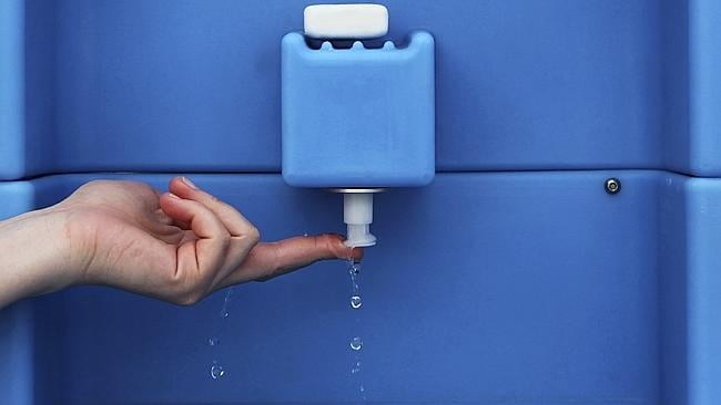 Innovative ... An exhibitor demonstrates the use of a toilet tap where water is recycled and reused, during Reinvent The Toilet Fair in New Delhi, India. Picture: AP