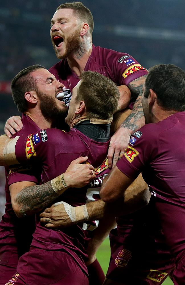 Darius Boyd celebrates scoring a try for Queensland.