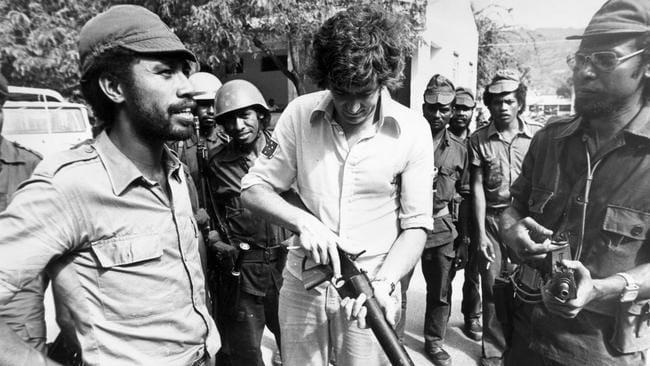 Rogero Lobato shows John Hamilton a captured grenade launcher in East Timor.