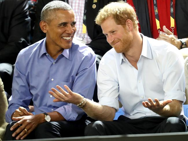Former US President Barack Obama and Prince Harry joke with each other as they watch the Invictus Games. Picture: Chris Jackson/Getty Images for the Invictus Games Foundation