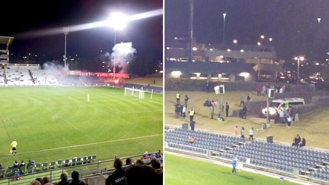 Pictures show a flare being set off at Campbelltown and an ambulance arriving to treat the injured.