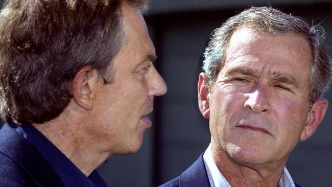 An image from September 2002 of US President George W. Bush (R) and British Prime Minister Tony Blair when they met privately at Camp David to discuss possible military intervention in Iraq. Picture: AFP