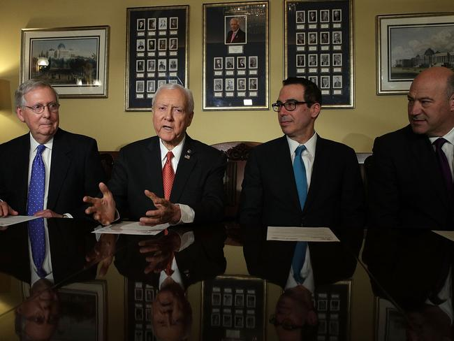 Mitch McConnell (far left) with fellow Republicans Orrin Hatch, Steven Mnuchin and Gary Cohn. Picture: Alex Wong/Getty Images/AFP