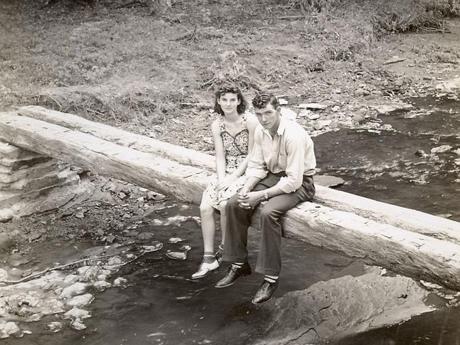 Happy together ... Kenneth and Helen Felumlee sitting on a log north of Zanesville before their marriage.