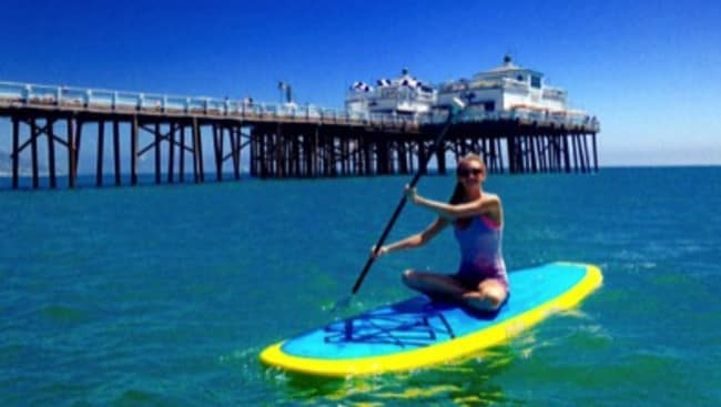 Paddle-boarding in California was one of her favourite free dates. Picture: Barcroft