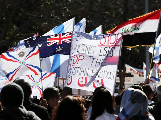 The Sydney Assyrian community march through the streets of Sydney CBD to protest over the murder of fellow Christians in Iraq , Picture Craig Greenhill