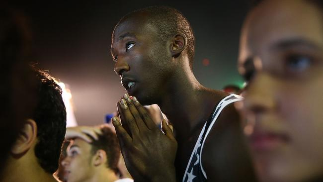 Let us pray: A fan on Copacabana Beach looks for divine intervention.