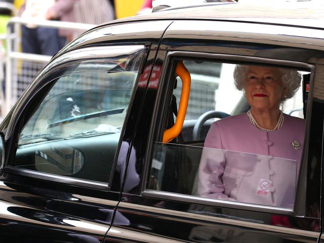 A waxwork of the Queen appeared outside the hospital in a black cab in a bizarre prank. Picture: AFP Photo / Isabel Infantes