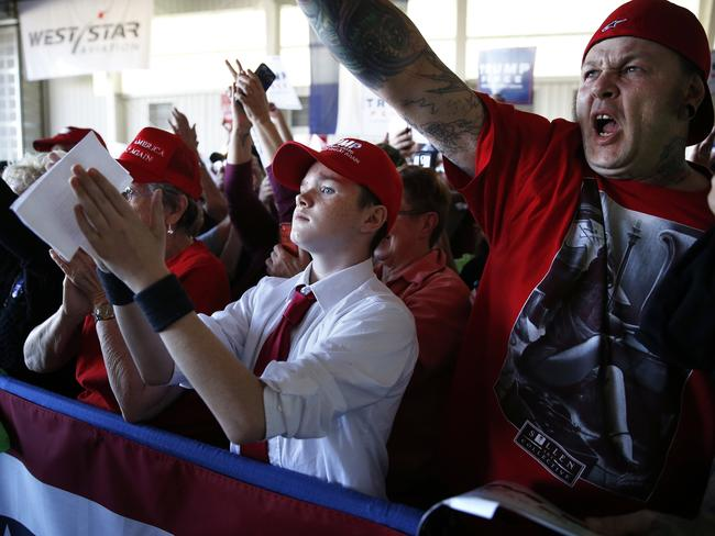 Trump supporters cheer as they listen to the Republican leader speak at a campaign rally in Colorado yesterday. Picture: Brennan Linsley
