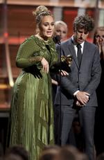 "Adele accepts the award for song of the year for ""Hello"" during The 59th GRAMMY Awards at STAPLES Center on February 12, 2017 in Los Angeles, California. Picture: AP"