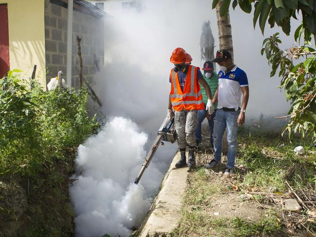 Dominican Air Force personnel fumigate an area of Santo Domingo against the Aedes aegypti mosquito, vector of the Zika virus. Picture: AFP
