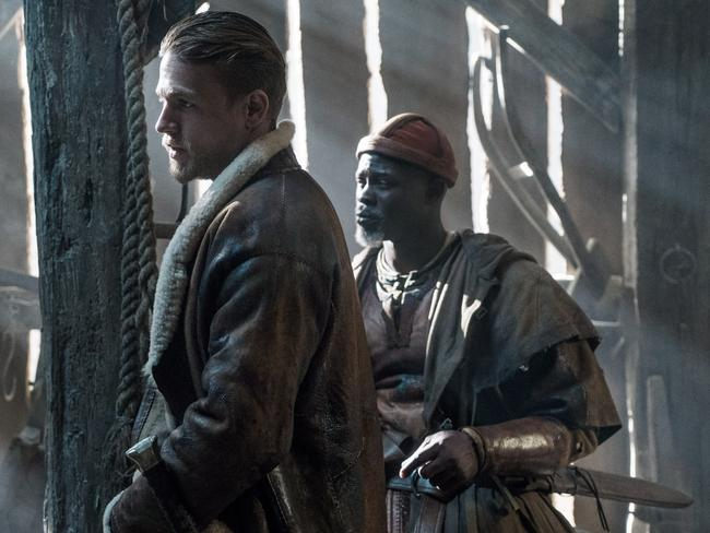 Hunnam and Djimon Hounsou in a scene from the film.