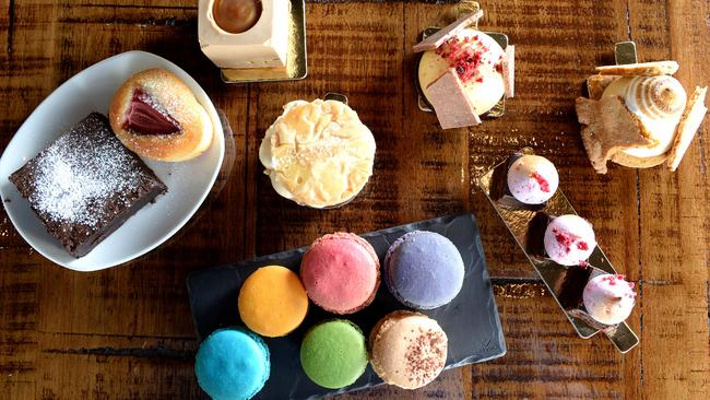 An assortment of cakes and macaroons from Devour Cafe Patisserie. Picture: Campbell Brodie