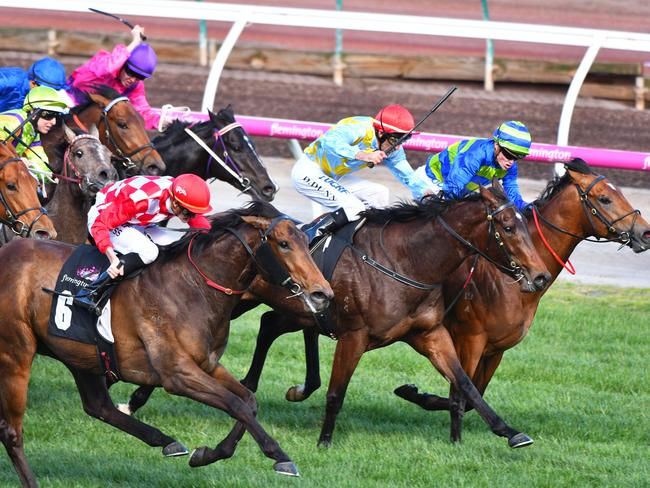 Catch me if you can: Regan Bayliss and Catchy (red/white silks) unleash a powerful finishing burst to overhaul the leaders in the Danehill Stakes. Picture: Getty Images
