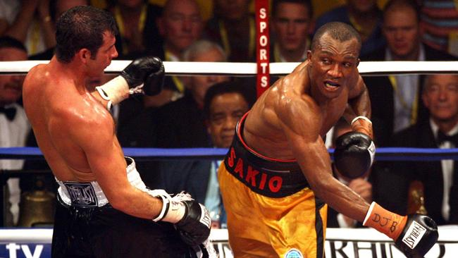 Joe Calzaghe, left, pulls back from Sakio Bika in 2006.