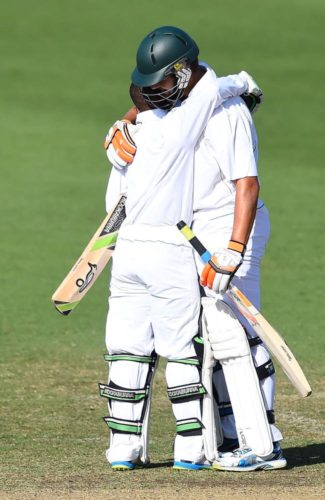 Temba Bavuma (L) is congratulated by teammate Rilee Rossouw after reaching a century.