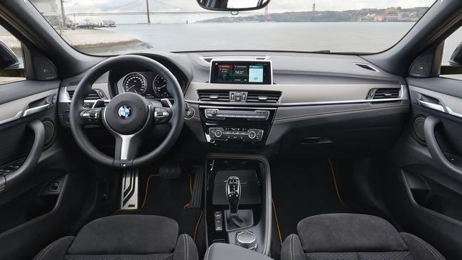 X2 cockpit: Ample space and shapely seats for driver and front passenger.