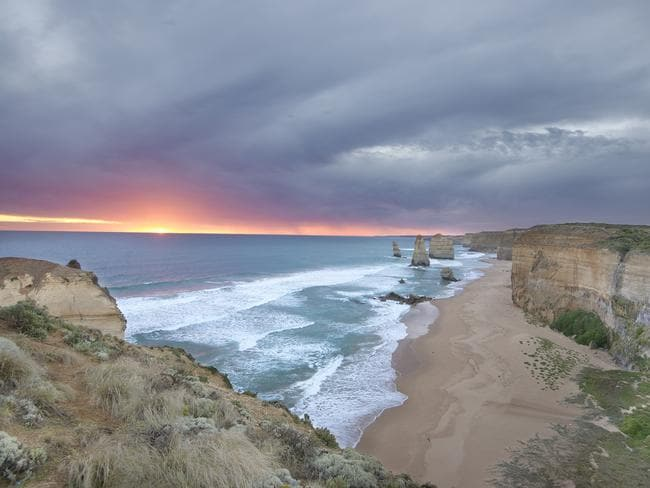 <b>28. TWELVE APOSTLES, VICTORIA:</b> I travelled across our deserts to visit Great Ocean Road, so after overcoming a bus breakdown, and spending hours by the side of a road in southern Victorian bushland, we made it to see the sunset over the Twelve Apostles. With only the last light of the sunset to capture, this photo reminds me there is light (beautiful light, no less) at the end of the tunnel! Picture: Suzanne Curtis, WA