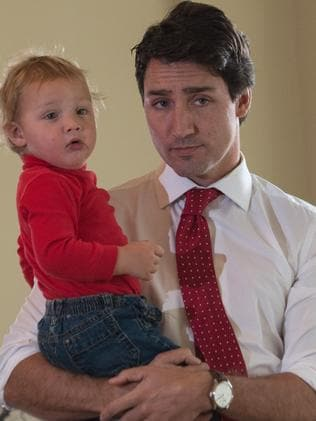 Justin Trudeau waits with his son Hadrien to cast his ballot. Nicholas Kamm/AFP Photo