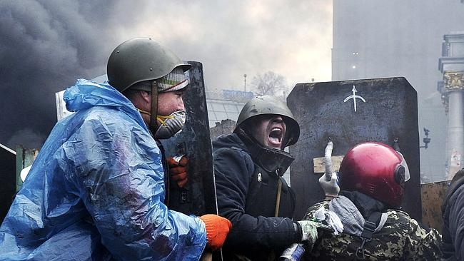 Pushing back ... Protesters advance to new positions in Kiev.