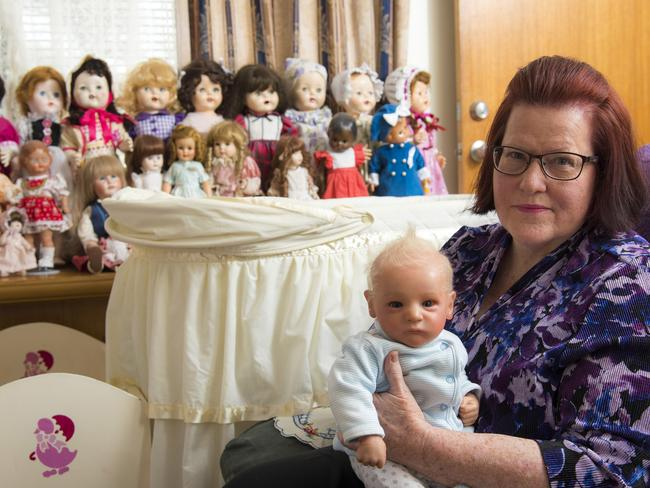 Betty with her doll, that resembles her son Greg when he was a baby. Picture: Caters