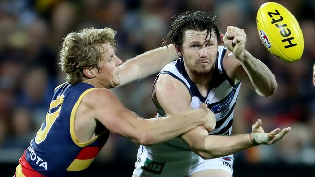 Both Rory Sloane and Patrick Dangerfield are in doubt for their sides' top-of-the-table clash on Friday night. Picture: Calum Robertson