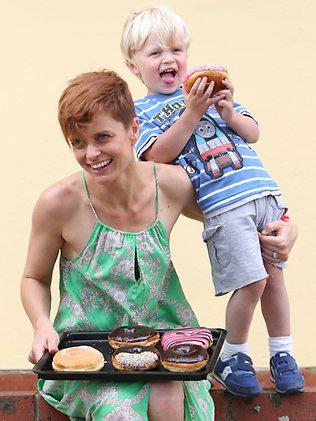 """Lucy Cornes and her son, Sonny, 3, enjoy some fare from her favourite bakery, Beck's Bakehouse, because they have the """"best doughnuts ever"""". Picture: Tait Schmaal"""