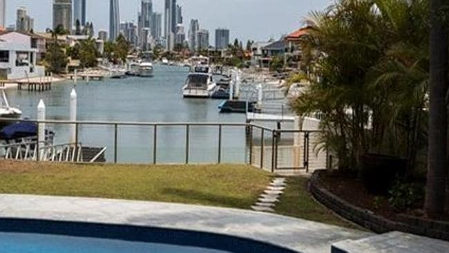 BOAT TO WORK: Why drive when you can pop into town in a boat from this four bedroom waterfront at Surfers Paradise? It comes with its own full size, flood lit tennis court.