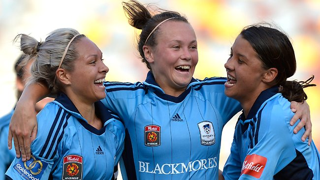 (L-R) Annalie Longo, Caitlin Foord and Samantha Kerr celebrate victory after the W-League Semi Final match between the Brisbane Roar and Sydney FC at Queensland Sport and Athletics Centre.