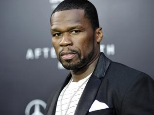 """FILE - In this May 29, 2013, rapper Curtis """"50 Cent"""" Jackson attends the """"After Earth"""" premiere at the Ziegfeld Theatre, in New York. Jackson has been charged with attacking his ex-girlfriend and trashing her Los Angeles condo last month. City Attorney Mike Feuer said Wednesday, July 3, 2013, the 37-year-old """"In da Club"""" singer is charged with domestic violence and vandalism. (Photo by Evan Agostini/Invision/AP, File)"""