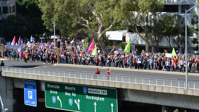 Thousands of teachers and supporters march through the city to Parliament House protestin