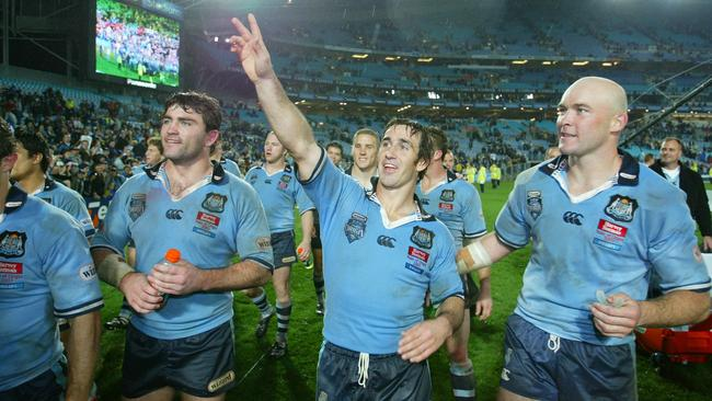 Andrew Johns and the Blues celebrate the 2003 State of Origin triumph.