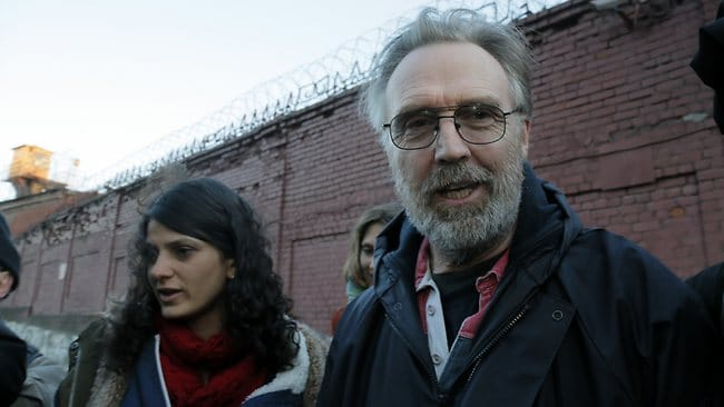 Australian Greenpeace activist Colin Russell leaves a jail after being freed on bail in St.Petersburg. Picture: AP
