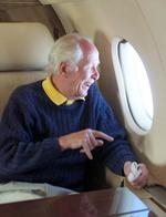 Ronnie Biggs in a private jet smiles as he sees his homeland of Britain for first time in 35 years. He is returning from Brazil where he has lived on the run following his escape from prison. Picture: London Sun.