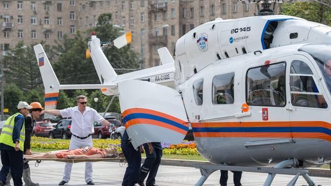 Rescuers and paramedics ... use helicopters to evacuate passengers injured. Picture: DMITRY SEREBRYAKOV