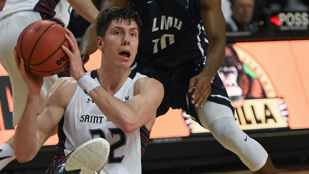 Dane Pineau scrambles for possession for St Mary's during a clash with Loyola Marymount. Picture: Getty Images