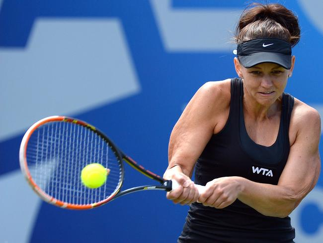 Go girl ... Casey Dellacqua has stormed into the semi-finals in Birmingham. Picture: AFP