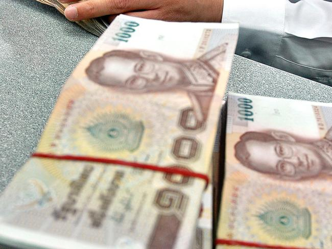 Thailand's treasury has announced new banknotes featuring the King Maha Vajiralongkorn, but most baht notes feature his late father, King Bhumibol Adulyadej Mahidol. Picture: AP