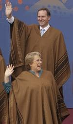 New Zealand's Prime Minister John Key, top, and Chile's Michelle Bachelet wear traditional Peruvian ponchos as they wave during the official group photo.