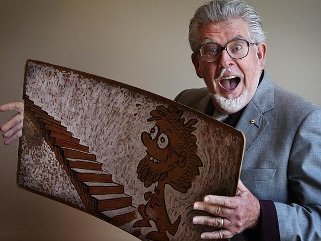 "The real deal ... Artist and singer Rolf Harris ""spluttered"" the sound of his iconic wobble board during his court appearance today."