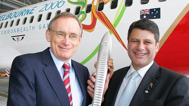 Frequent flyer ... Bob Carr and Steve Bracks with the Queen's Relay baton in front of the 2006 Commonwealth Games Qantas 737 plane.
