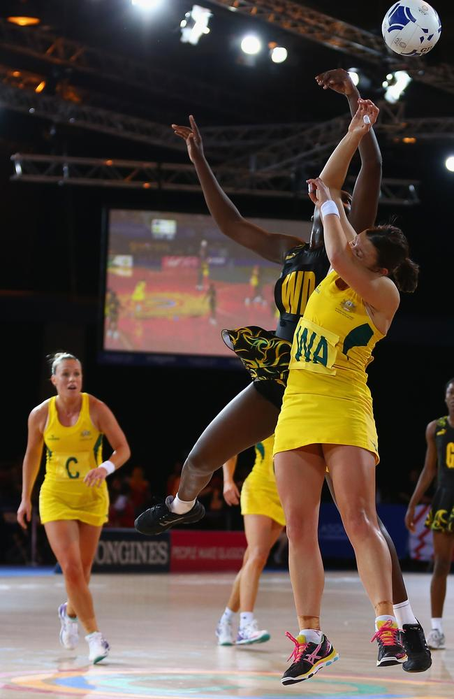 Madi Robinson of Australia is challenged by Vangelee Williams of Jamaica.
