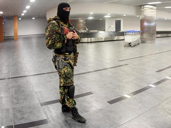 Baggage area... Pro-Russian militants take up their positions in the international airport. Picture: Alexander Khudoteply